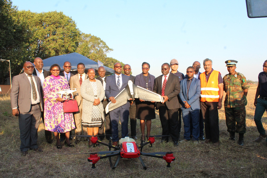 Minister poses for a photo after the demonstration of the Flying Lab at the Goma fields