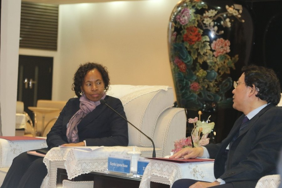 Permanent Secretary Ministry of Higher Education, Ms Kayula Siame receiving a brief from the XJTU Vice President Professor Xi Guang